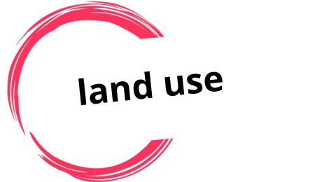"""This is a logo with the words """"land use"""" surrounded by incomplete circle drawn in red brushstroke style."""