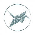 Blue Origami Crane with classic japanese graphic design inside circle
